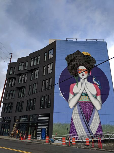 PAMPLIN MEDIA GROUP: JOSEPH GALLIVAN - The image of a woman in a pose of gratitude, with more than 1,000 plants for hair, is a 70-foot-tall image painted by London-based muralist Fin DAC