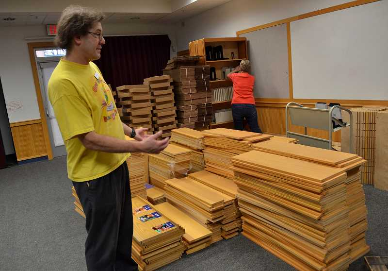Library Services Manager Steven Engelfried scans the stacks of shelves that have been removed from the childrens area.