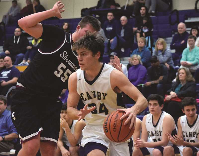 HERALD PHOTO: TANNER RUSS - Canby senior Jacob Huggins had four points and three defensive rebounds after nearly six minutes against the Sherwood Bowmen on Tuesday, Jan. 30.