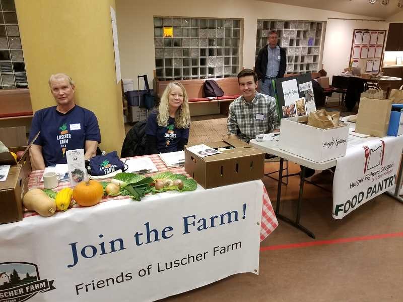 REVIEW PHOTO: ANTHONY MACUK - City and community groups set up display tables at the Lake Oswego Sustainability Networks celebration last week, including Luscher Farm and Hunger Fighters Oregon. From left: Jeff Wiens, Kathleen Wiens and Michael Murray.