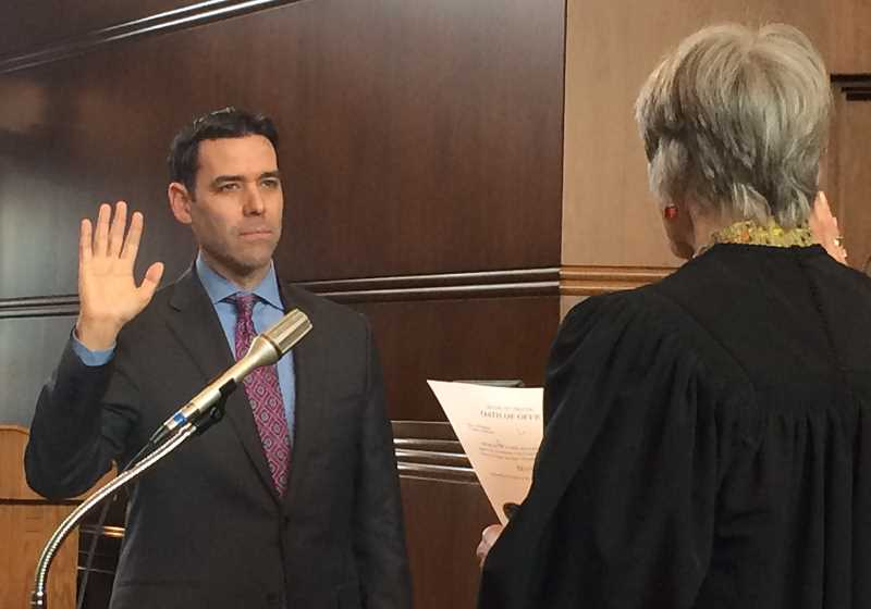 SUBMITTED PHOTO - New state Sen. Rob Wagner takes the oath of office Wednesday in Salem. The Lake Oswego School Board member was appointed Jan. 29 to serve the remainder of former Sen. Richard Devlin's term in Senate District 19.