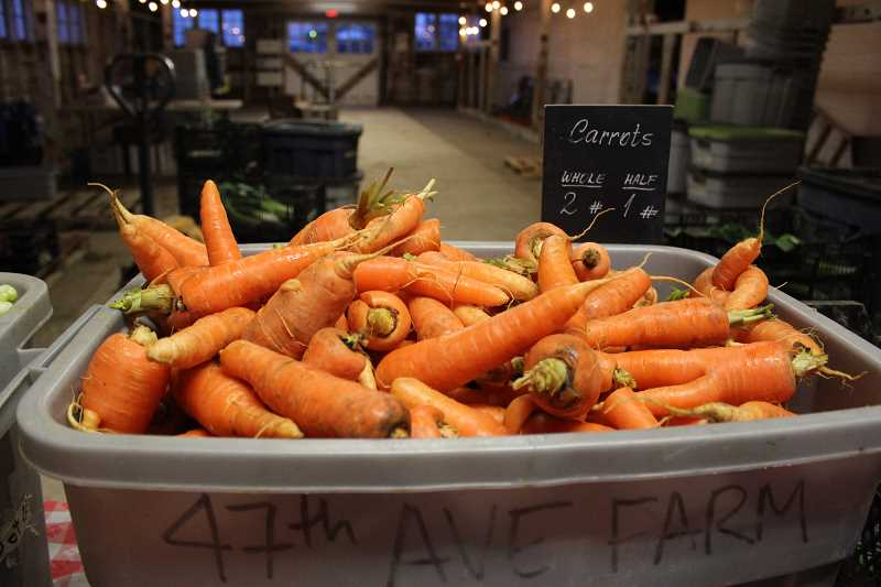 REVIEW PHOTO: SAM STITES - Fresh carrots, red onions, leaks, kale and much more are available as part of Community Supported Agriculture's winter crop.