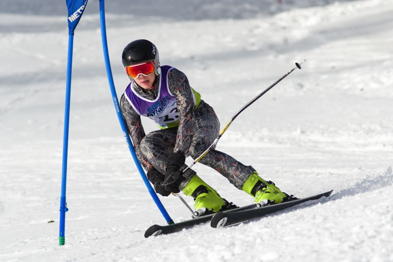 PHOTO COURTESY OF MIKE JULIANA - Tigard's Tyler Olson competes in the Metro League giant slalom event.