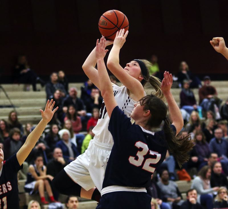 DAN BROOD - Tualatin junior Anna Withers goes to the basket during the win over Lake Oswego.