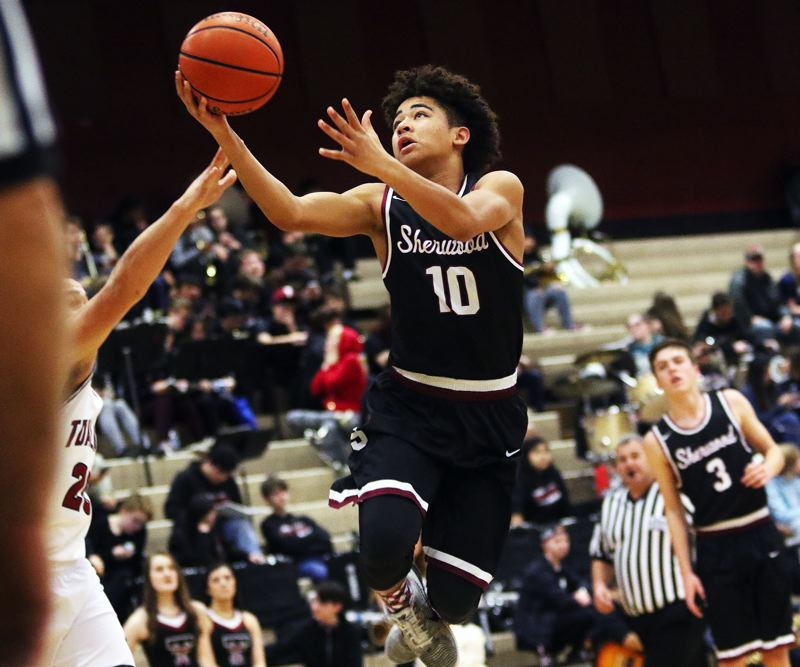 DAN BROOD - Sherwood High School sophomore guard Jamison Guerra goes up to the basket during Friday's game at Tualatin. Guerra had 10 points and six rebounds for the Bowmen in their victory.