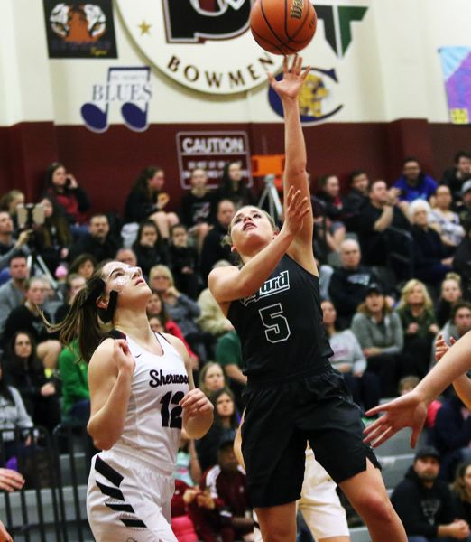 DAN BROOD - Tigard senior Gabby McGaughey (right) takes a shot during the Tigers' win at Sherwood.