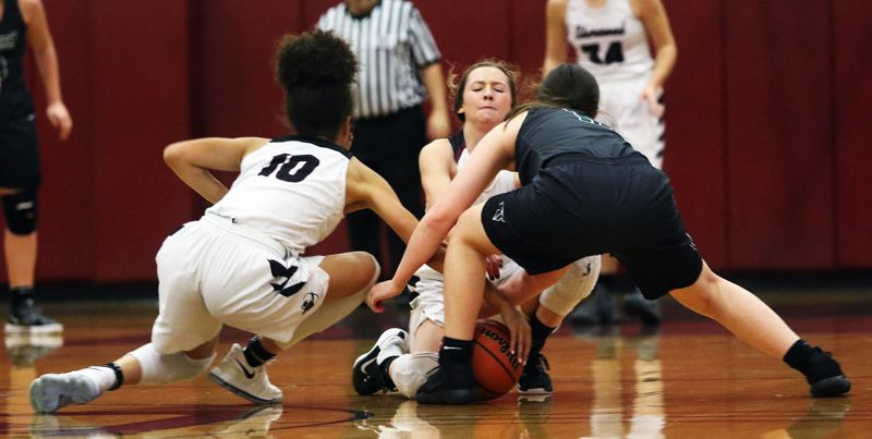 DAN BROOD - Sherwood's Kylah Williams (10) and Ava Boughey and Tigard's Paige LaFountain battle for a loose ball.