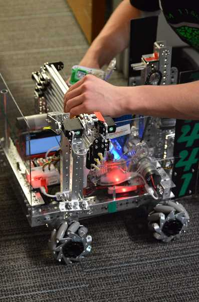 PAMPLIN MEDIA GROUP PHOTO: CLARA HOWELL  - Teams bring in smaller robots to work on since they are easier to manuever.