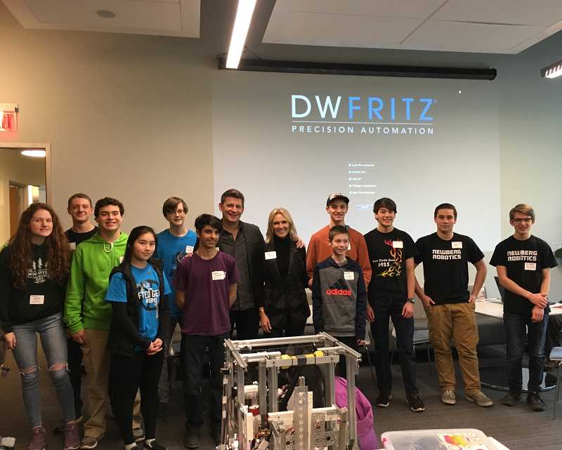 PAMPLIN MEDIA GROUP PHOTO: CLARA HOWELL  - Mike Fritz and his wife pose with representatives from each robotics team at 'Bring Your Problem to Work Day.'