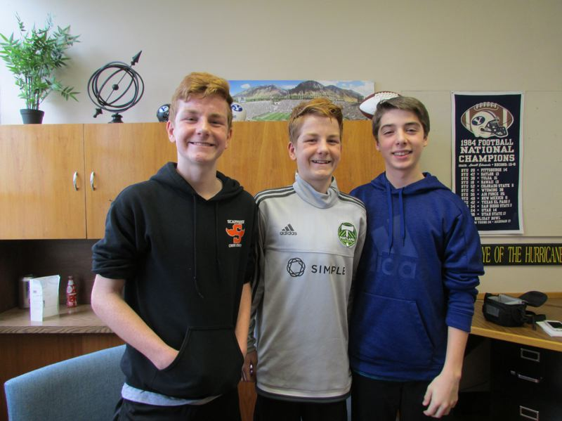 SPOTLIGHT PHOTO: NICOLE THILL - Rowen Suchoski, Luke Suchoski and Mason Earl, three eighth-graders at Scappoose Middle School, are working to fundraise money to purchase and install a water bottle fill station. The boys have collected $180 so far and are planning to launch other fundraising efforts to collect $1,000, the estimated cost it will take to install.