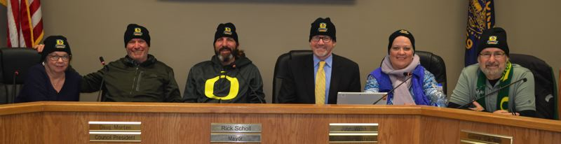 COURTESY PHOTO - The St. Helens City Council wears black beanies embroidered with the Spirit of Halloweentown logo on them. Beanies, t-shirts, coffee mugs and other items will be sold at a specialty gift shop and museum in the Masonic Lodge building on 1st Street in St. Helens.