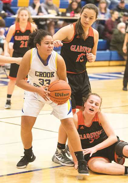 LON AUSTIN/CENTRAL OREGONIAN - Odessa Tramel-Green pulls down one of her 11 rebounds against the Gladstone Gladiators. Tramel-Green also led the Cowgirls in scoring with eight.