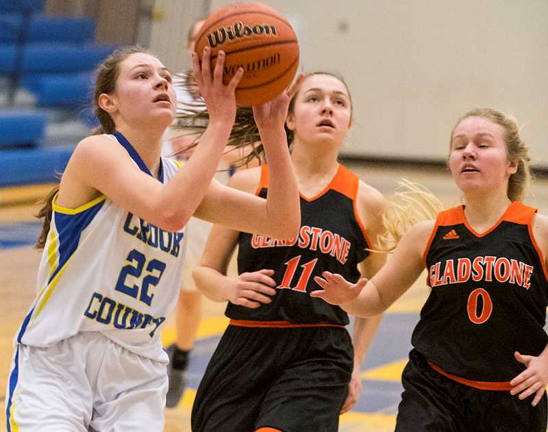 LON AUSTIN/CENTRAL OREGONIAN - McKinzee Mode goes to the hoop for two of her five points in the Cowgirls' loss to Gladstone on Monday.