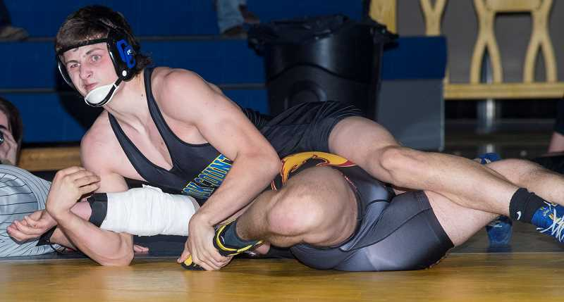 LON AUSTIN/CENTRAL OREGONIAN - Jaxson Rhoden pins Redmond's John Crivellone early in the second round of their 195-pound match. Rhoden's pin in the final match of the night put an exclaimation point on the Cowboys' dominant 51-12 win over the Panthers.