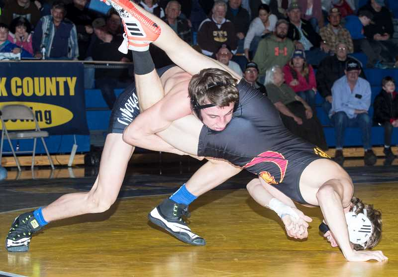 LON AUSTIN/CENTRAL OREGONIAN - Zachary Mauras takes down Redmond's Jacob Curry. Mauras earned a close 5-4 decision over the second-ranked Curry.