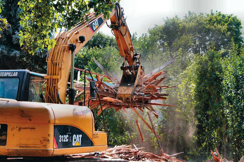 FILE PHOTO  - Home demolitions must be done more safely to protect neighbors from lead dust and asbestos, under a new city ordinance that takes effect by July 1.
