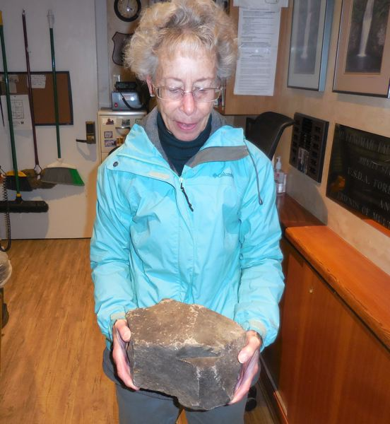 CONTRIBUTED PHOTO: RON GOODWIN - Katie Goodwin holds a 25-pound piece of basalt, which fell near the Multnomah Falls Lodge in December.