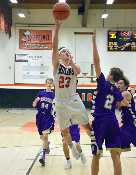 SPOTLIGHT PHOTO: JOHN BREWINGTON - Scappoose senior guard Jared Toman goes to the basket during his team's 55-47 home win over Astoria on Wednesday night.