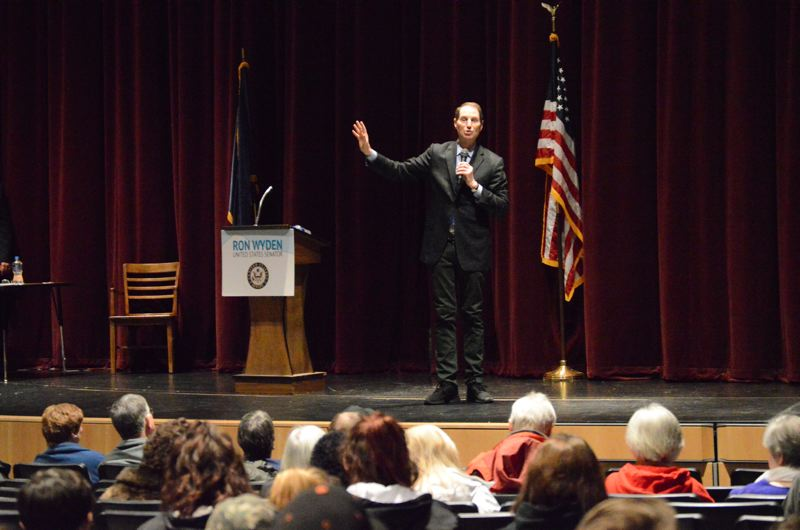 SPOTLIGHT PHOTO: NICOLE THILL - U.S. Sen. Ron Wyden speaks at a town hall meeting in Scappoose on Friday, Feb. 2. During the event high school students and community members were given the chance to ask questions about a variety of topics.