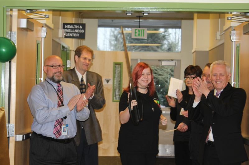 PHOTO BY: MADISON DALLING-RAISNER - Rex Putnam senior Myri Dublin cuts the ribbon on the high school's new health center on Jan. 26. Looking on, from left, are NCSD Director of Social Services Michael Ralls, Dr. Wayne Sells and Superintendent Matt Utterback.