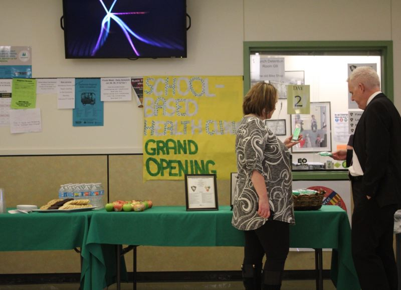 PHOTO BY: MADISON DALLING-RAISNER - About 100 people attended the Jan. 26 opening of the Rex Putnam High School health center.