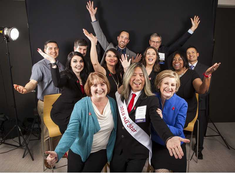 SUBMITTED PHOTO - Candidates for the Leukemia & Lymphoma Society's Man & Woman of the Year fundraising contest gather for a group photo. Back row (from left): Roberto Flores, Roger Devine, Kevin Kirkpatrick, Dan Snyder and Marlin Bernabe. Middle row: Julie LaPierre Dent, Milissa Ormiston, Sunny Freeman and Dr. Cynthia Viola Harris. Front row: Kay Dee Cole, Blake Sakamoto and Kirsten Leonard. Not pictured: Amy Nasset and Ashley Miles.