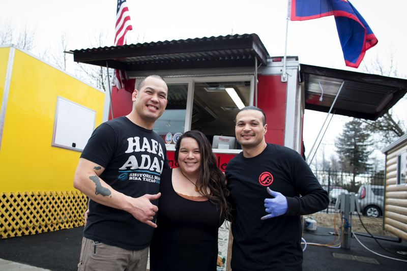 TIMES PHOTO: JAIME VALDEZ - Tommy Grajo, his wife, Bertina, and Kali Matanane celebrate the opening of their food cart, Marianas foot cart at BG Food Cartel.