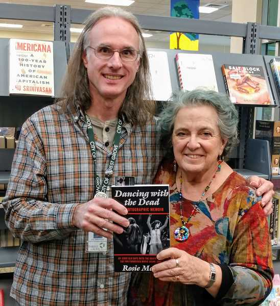 COURTESY PHOTO - Rosie McGee posed with Forest Grove librarian Jim Jatkevicius when she donated a copy of her book to the library.