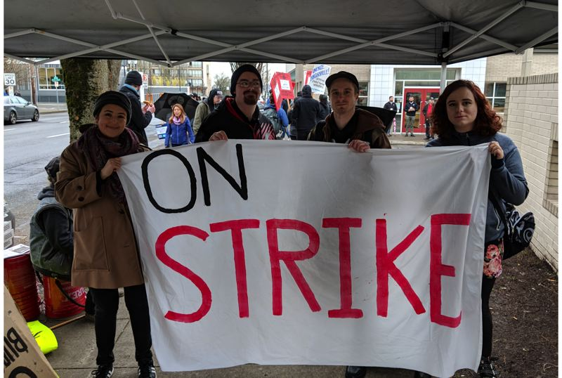 PAMPLIN MEDIA GROUP: JOSEPH GALLIVAN - (L-R)  Michelle Ceballos, Emmett Schlenz, Chris Merkle and Serenity Vickery at the Burgerville three day strike Thursday.