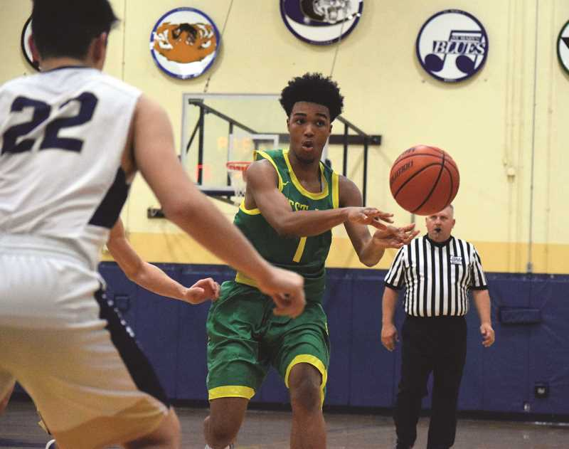 HERALD PHOTO: TANNER RUSS - West Linn's Micah Garrett had 13 points and three assists in West Linn's 61-44 win over Canby.