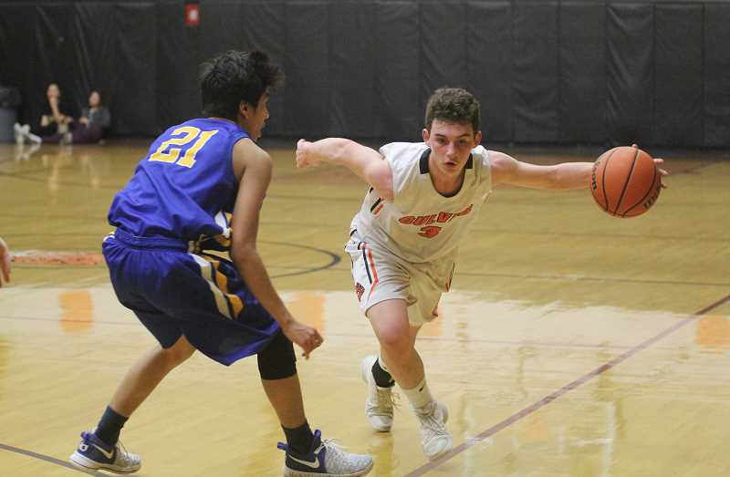 WILL DENNER/MADRAS PIONEER - Weston Basl (3) drives past Stanfield's Elias Esquivel during the second quarter of Friday's game.