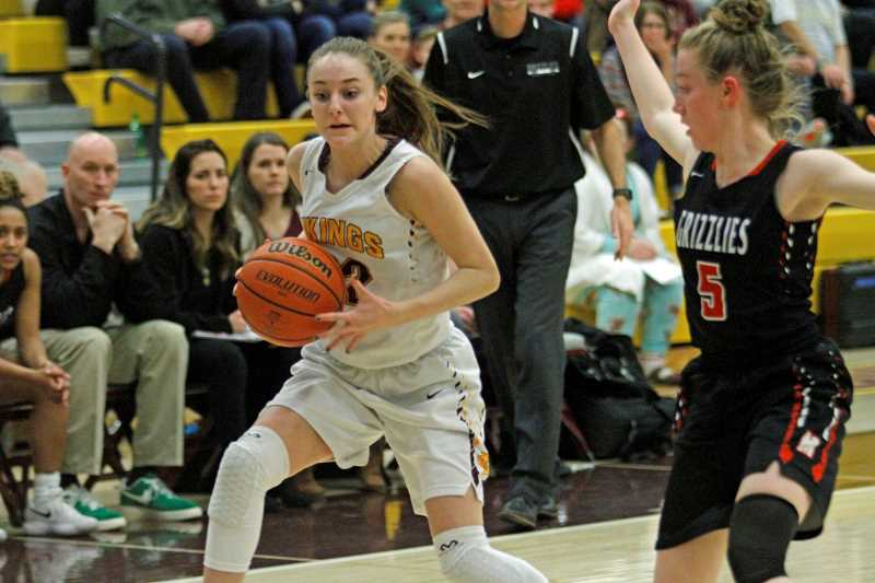 STAFF PHOTO: WADE EVANSON - Forest Grove sophomore Audrey Fasching dribbles around a McMinnville defender during their game against the Grizzlies Feb. 7 at Forest Grove High.