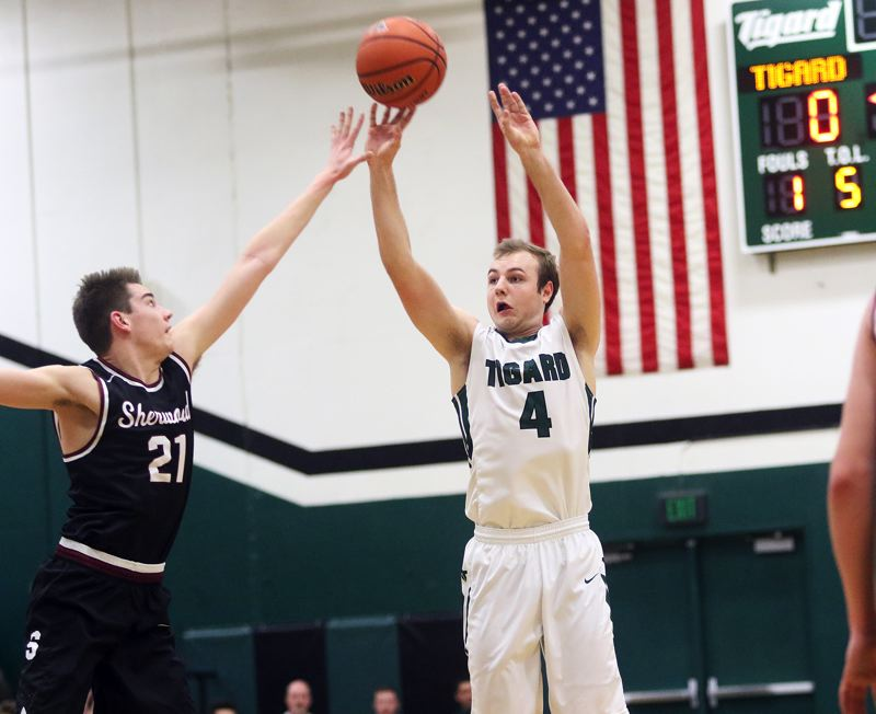 DAN BROOD - Tigard junior Stevie Schlabach (right) shoots over Sherwood junior Braden Thorn during Friday's game.