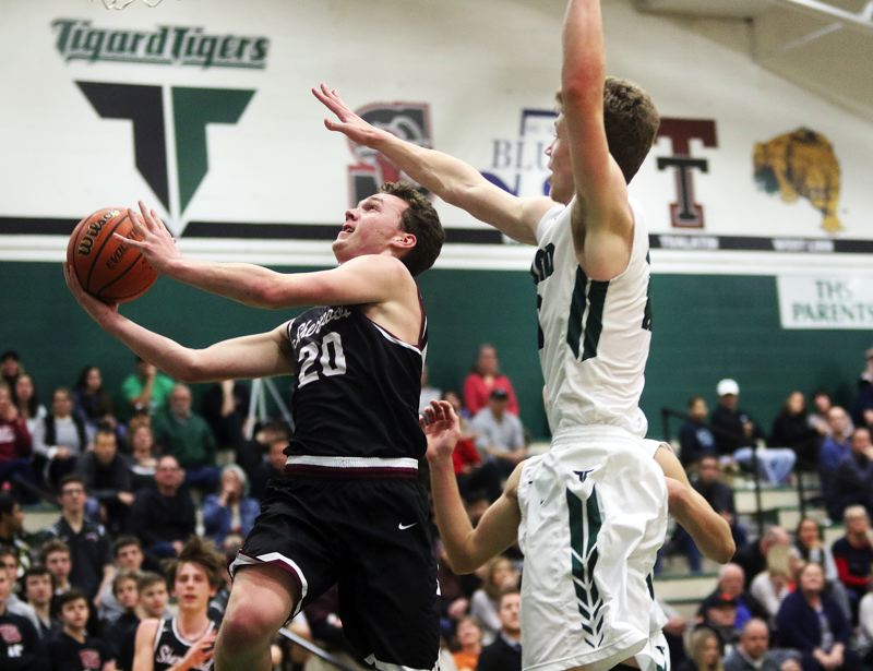 DAN BROOD - Sherwood senior Owen Grubbe (left) looks to put up a shot during Friday's game at Tigard.