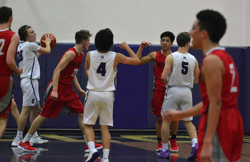 TIMES PHOTO: MATT SINGLEDECKER - Westview senior point guard Eric Anderson celebrates an and-one three-point play against Sunset.