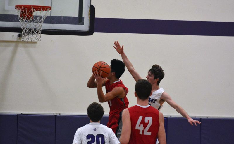 TIMES PHOTO: MATT SINGLEDECKER - Sunset senior forward Coleman Newsom tries to block Westview senior Eric Anderson.