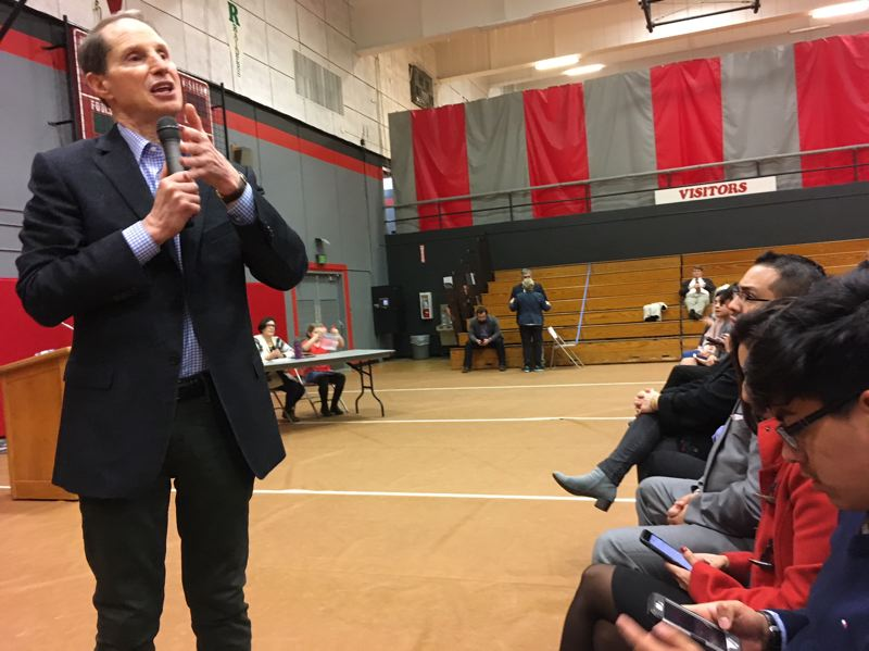 PAMPLIN MEDIA GROUP: PETER WONG - U.S. Sen. Ron Wyden, D-Ore., makes a point about ongoing investigations into Russian interference in the 2016 U.S. presidential election during a town hall meeting Friday night (Feb. 2) attended by more than 300 at David Douglas High School in Portland.