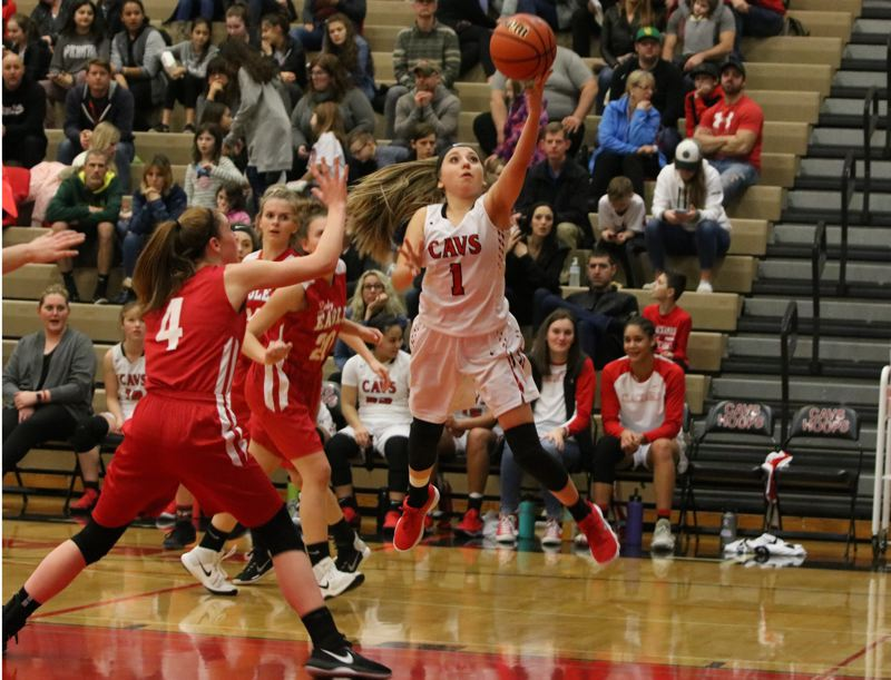 REVIEW/NEWS PHOTO: JIM BESEDA - Clackamas' Payton Mongelli (1) glides to the basket during the fourth quarter of Friday's 74-27 Mt. Hood Conference girls' basketball home win over Centennial.