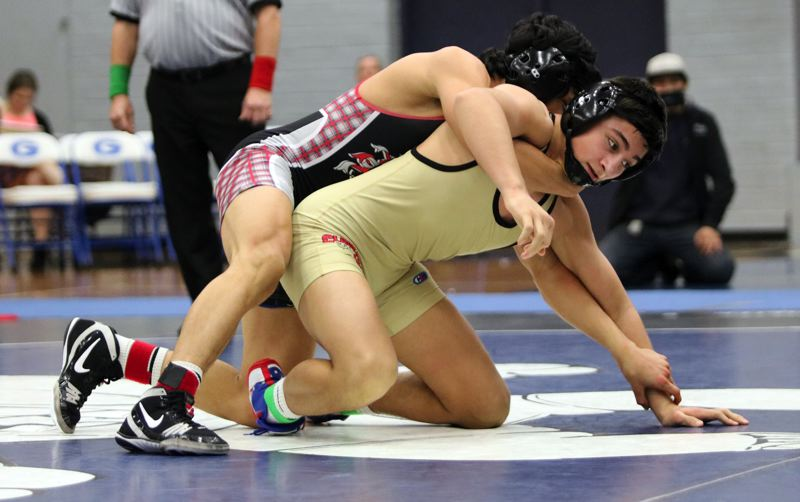 REVIEW/NEWS PHOTO: JIM BESEDA - Clackamas' Noah Wachsmuth went 4-0 with four falls to wrap up the 145-pound title at the two-day Mt. Hood Conference wrestling championships at Gresham High School.