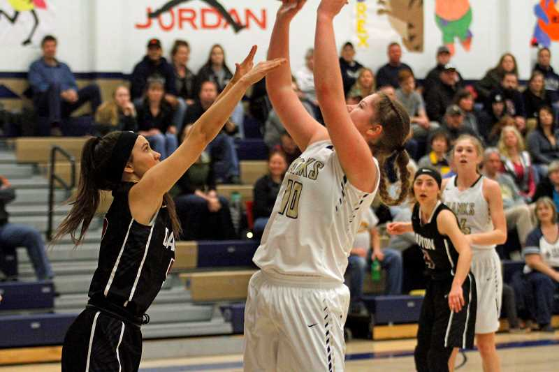 STAFF PHOTO: WADE EVANSON - Banks senior Jessi Wren goes up for a shot during the Braves' game against Dayton Feb. 3 at Banks High School.