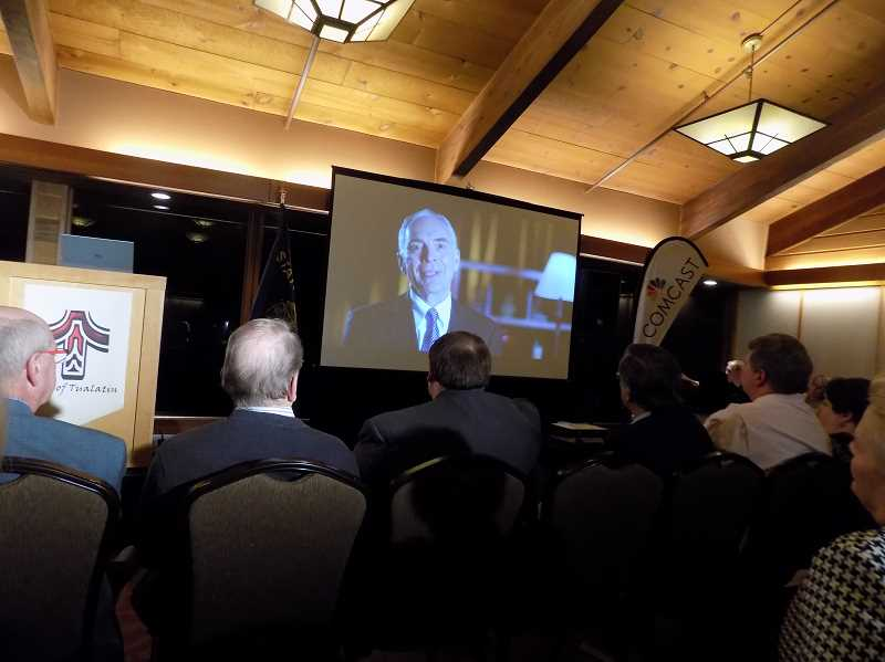 TIMES PHOTO: RAY PITZ - Area mayors and members of the Tualatin City Council listen to Lou Ogden speak about the accomplishments of the last 25 years during a video segment of his State of the City speech.