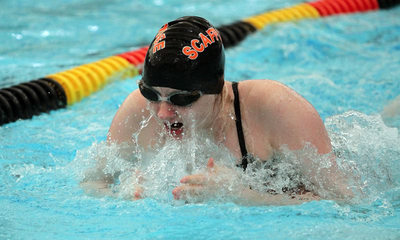 SPOTLIGHT PHOTO: MILES VANCE - Scappoose junior Montana Poppenhagen swims the breaststroke leg of the 200-yard medley relay during Friday's Cowapa League championship meet at Eisenschmidt Pool in St. Helens.