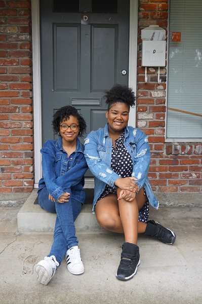 REVIEW PHOTO: CLAIRE HOLLEY - A'jialia McClure and Dakota Webb say they lean on each other and on their friend Christaaan Bedford for support at school. 'We just need to stand together,' A'jialia says. 'And if it's only us three standing together, well that's just how its gonna have to be.'