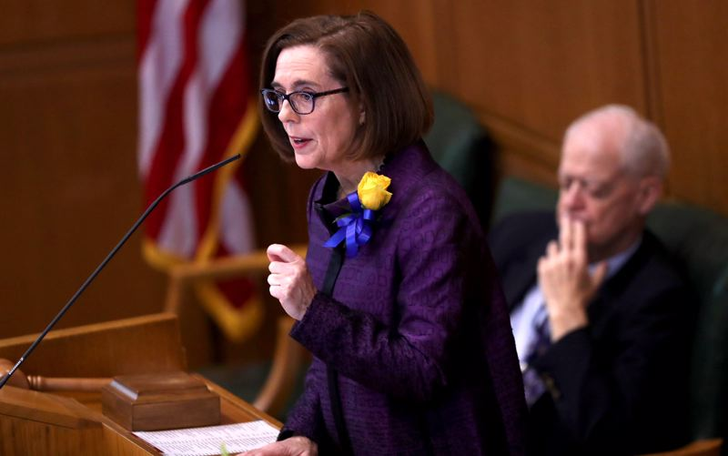 JAIME VALDEZ/PORTLAND TRIBUNE - Gov. Kate Brown delivers her state-of-the-state address at the Oregon Capitol Monday.