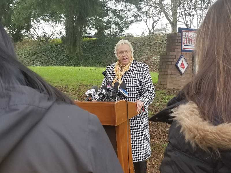 REVIEW PHOTO: GARY M. STEIN - Christine Moses, executive director of communications for the Lake Oswego School District, addresses the media Monday at a short press conference in front of Lake Oswego Junior High.