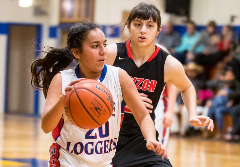 LON AUSTIN/CENTRAL OREGONIAN - Maria Vargas drivs past pressure defense from Horizon Christian's Alexis Ruiz. Vargas finished with 10 points and five rebounds for the Mitchell/Spray Eagle/Loggers, but it wasn't enough as the Hawks took a 56-32 victory.