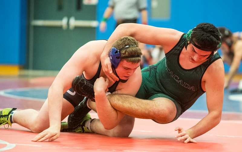 LON AUSTIN/CENTRAL OREGONIAN - Caleb Parrott takes down Estacada's Hunter Gotchall. Parrott, who is ranked second in the state, in his weight class, pinned Gotchall, who is ranked fourth just 54 seconds into the match. The Cowboys won the dual 55-21.