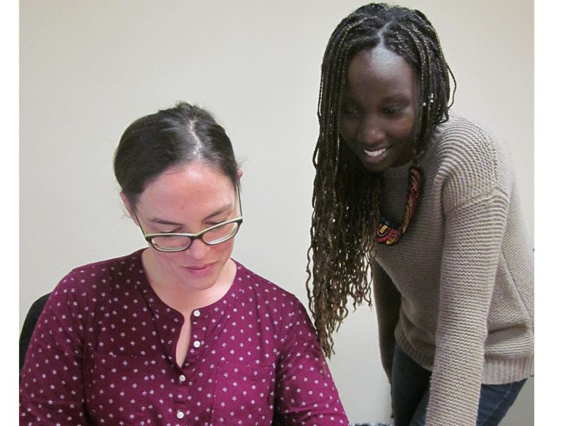 PHOTO BY ELLEN SPITALERI - Jennifer Carter, left, program assistant, and Pauline Burkey, program manager for Metro HomeShare, check out a potential client list.