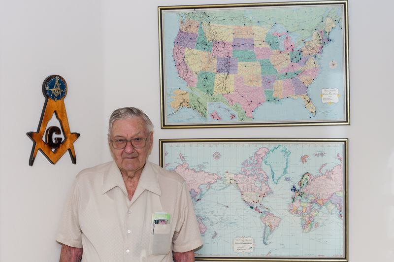 STAFF PHOTO: CHRISTOPHER OERTELL - On the wall of his apartment at the Jennings McCall Continuing Retirement Community in Forest Grove, 99-year-old Harold Johnson keeps maps with pushpins to mark all of the places he has visited in his life.