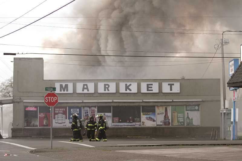 PHIL HAWKINS - Black smoke billows out of Young Street Market on Monday morning.